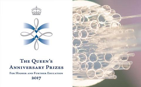 Queen's Anniversary Prize logo with fibre optic lights behind