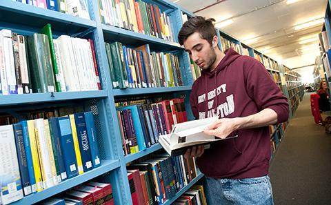 Student looking at a book