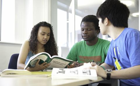 Three students in the library