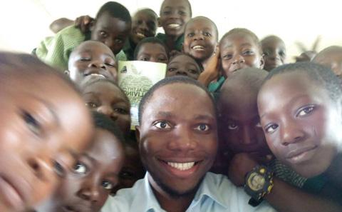 Okanda with some of his pupils