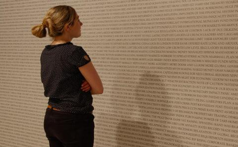 Woman and wall of words