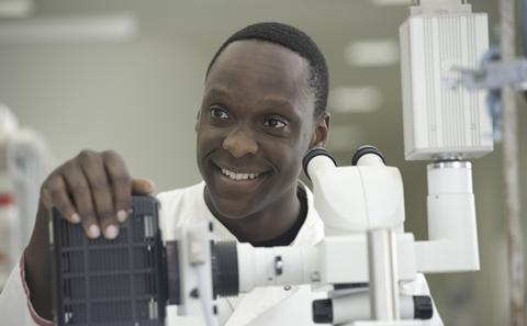picture of student at microscope