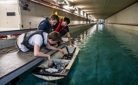 Students testing a craft at a wave simulation facility.