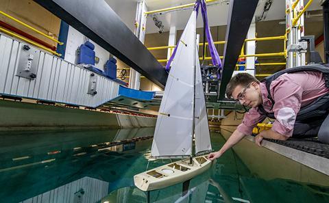 Student testing a small sailboat.