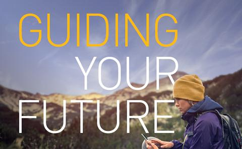 """Hiker sat at the top of a hill with the text """"Guiding Your Future"""""""
