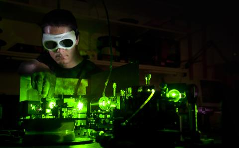 student studying green light experiment