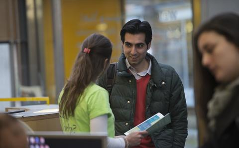 A student and advisor at the Student Services Centre