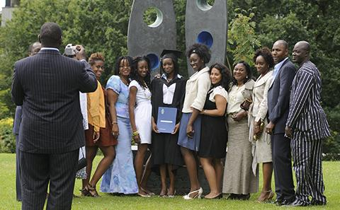 A graduating student with family