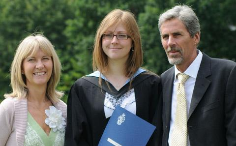parents with student at graduation