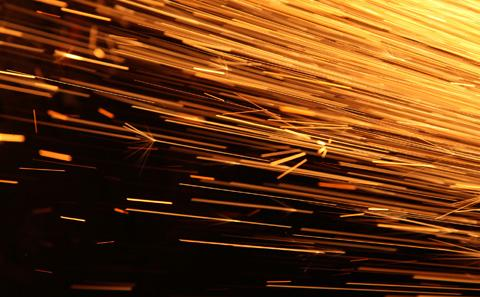 Sparks flying during manufacturing process.