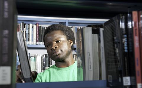 An alumnus using the library