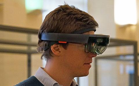 A researcher wearing a HoloLens AR headset