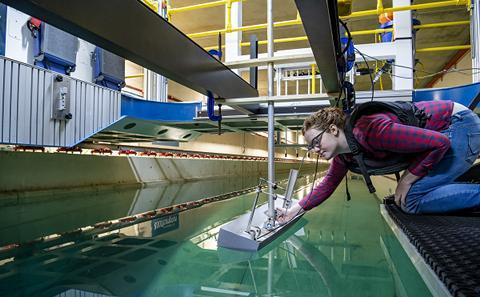 Students at work at a wave simulation facility.