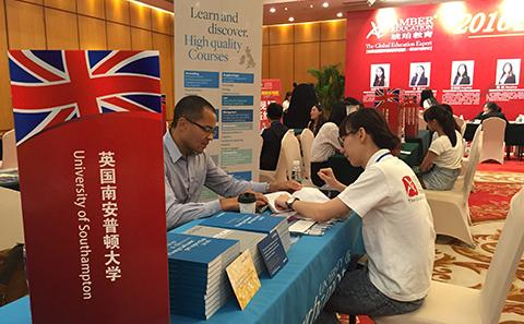 Student getting help at an overseas exhibition