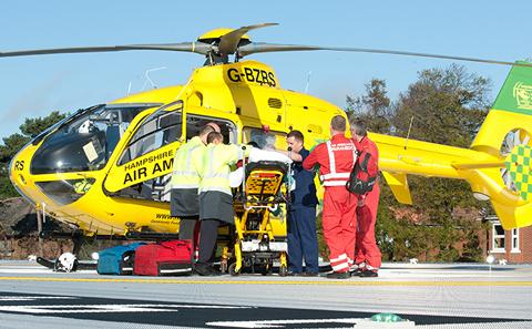 Emergency care helicopter on hospital roof