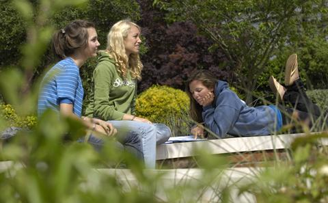 Students sat in the gardens area on our Highfield Campus.
