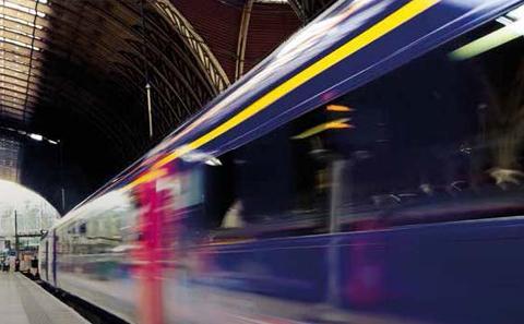 Train speeding through a railway station