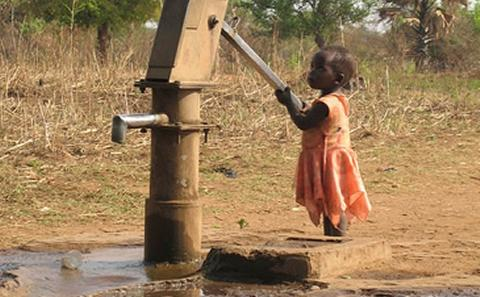 Image of child at water pump