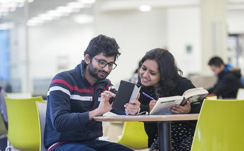 International students studying in the library