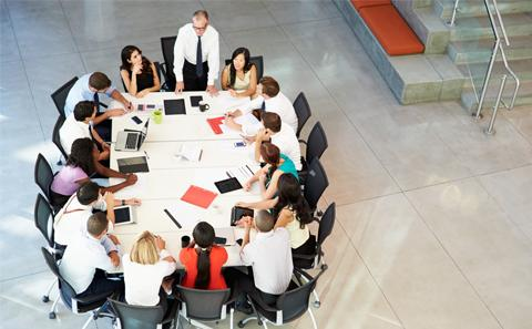 group of business people around a table