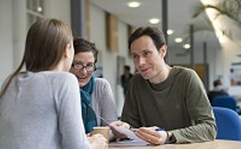Student meeting a member of University staff