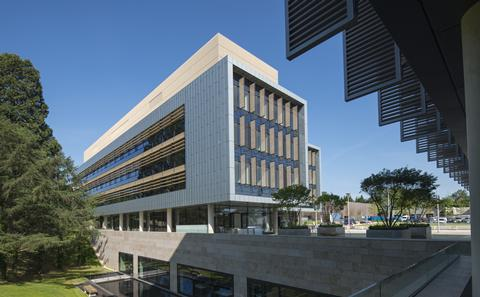 modern white building on bolderwood campus