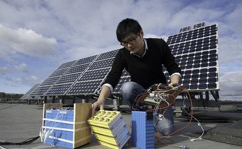 A student sets up solar panels