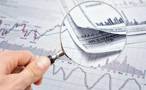 magnifying finance report