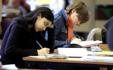 Student writing in an exam