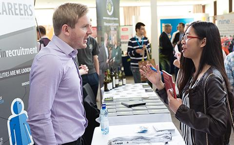 A member of staff talking to a student at a careers event