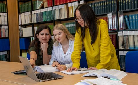 Law students in the library studying