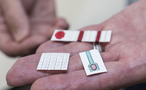 Paper sensors held in a hand.