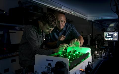 researcher with green lights