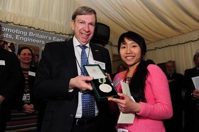 STEM for Britain poster prize winner ThaoNguyen Nguyen receiving the Roscoe Medal.