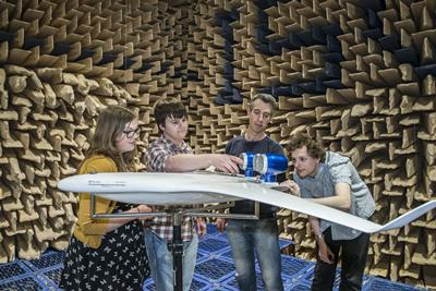 Jessica and her group with their model in the anechoic chamber