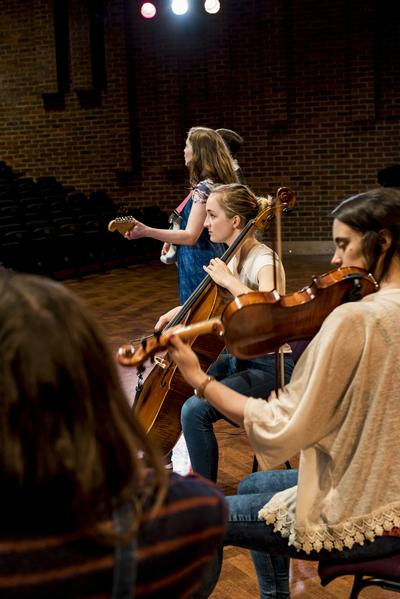Students practicing with instruments
