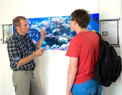 Prof Jörg Wiedenmann by the Coral Tank