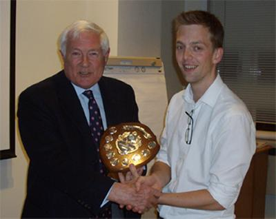 Richard Fox presenting Mike with his award