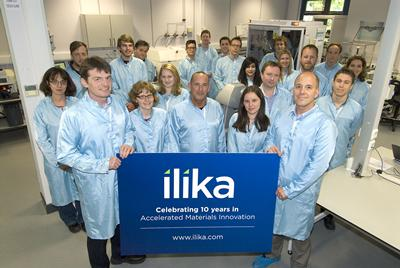 Graeme Purdy, CEO, Ilika and Steve Boydell, Finance Director, Ilika holding 10 year banner with Ilika team.