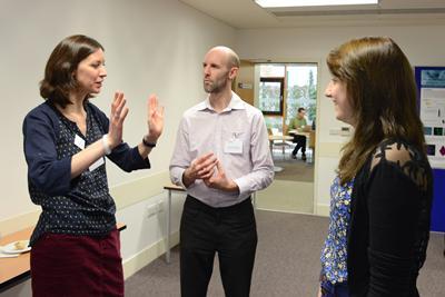 3 members of NAMRIP discussing their research
