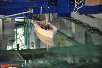 Towing tank testing of the scale model ship