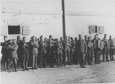 The camp orchestra perform in the Janowska concentration camp