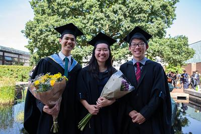 Three students of the class of 2019