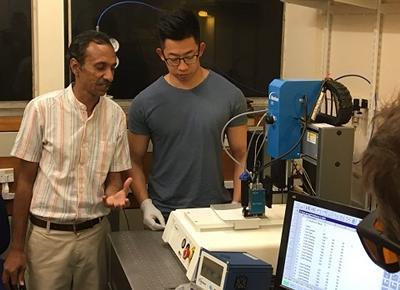 Dr Collin Sones and Dr Peijun He laser printing wells in paper