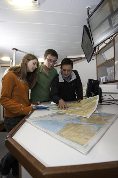 Reviewing deep-ocean charts onboard Callista