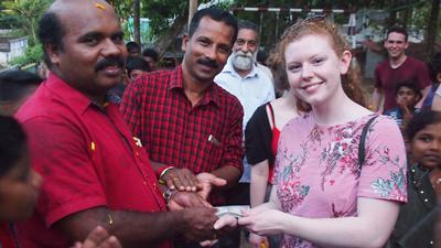 3 smiling people set in Kerala, India