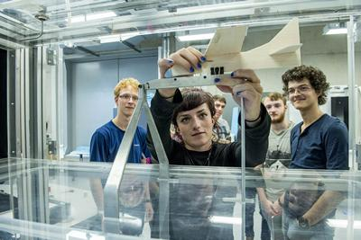 Students testing their glider design in a wind tunnel