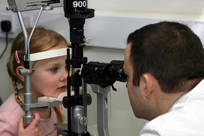 Examining a child in clinic