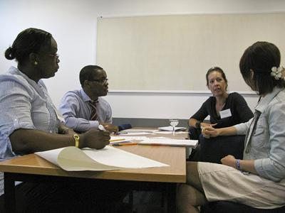Student Charles Iwegbu leads delegate discussion of IPE and patient safety during group activity