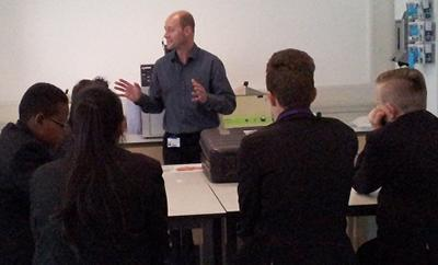 Dr Rod Hervé talking to secondary school students